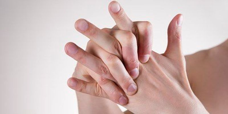 Collapsing Bubbles May Make Knuckle Cracks Noisy